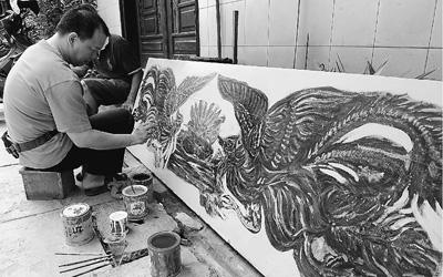 ...雅加达,一位华人在班芝兰区华人寺庙图片 84582 400x250