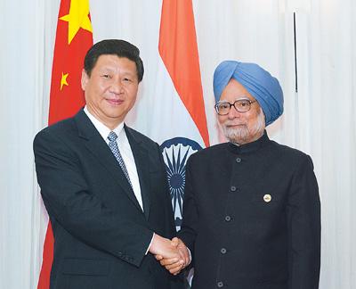 2013年3月27日,国家主席习近平在南非德班会见印度总理辛格.新华图片