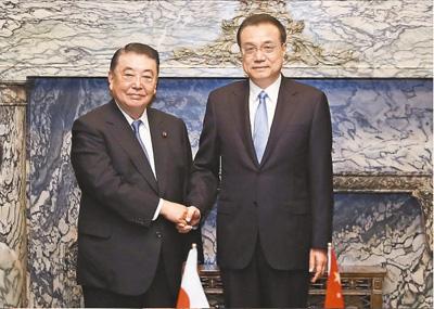 李克强分别会见日本众议长、参议长