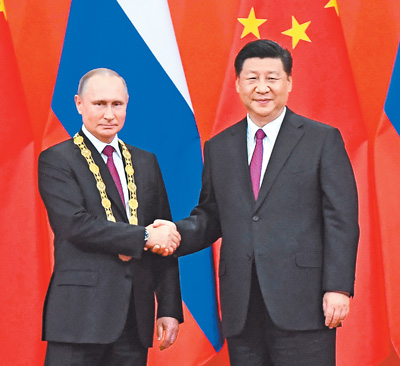 """中华人民共和国""""友谊勋章""""颁授仪式在京隆重举行"""