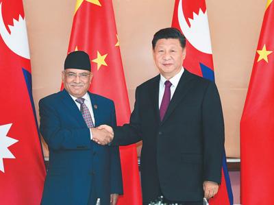 银河6163线路检测会见尼泊尔共产党联合主席普拉昌达