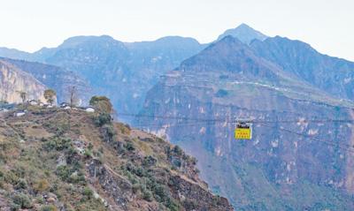 """高空建索道连通悬崖村 最后一个""""无公路村""""打通了对外通道"""