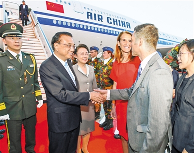 李克强抵达布鲁塞尔出席第十二届亚欧首脑会议并对比利时进行工作访问
