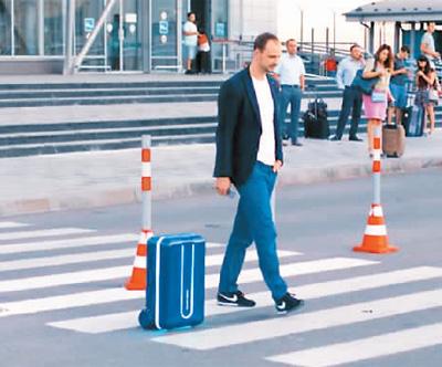 旅行神器超实用:自动化行李箱 跟着主人走