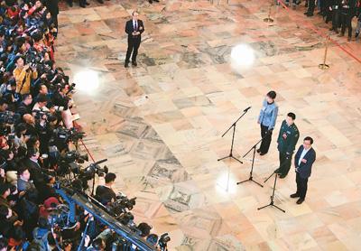 全球媒体热议中国两会: 开放程度高 改革前景好