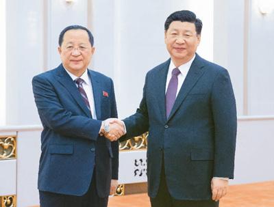 习近平会见朝鲜外相李勇浩